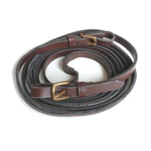 Tynd brund lædertøjle med messing/guldfarvede spænder